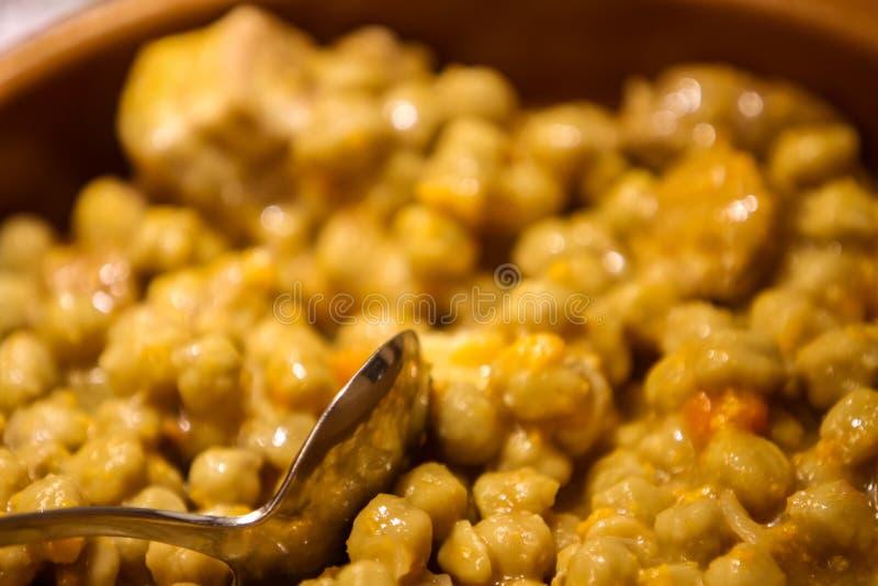 Callos con garbanzos. Closeup view at traditional spanish meal callos con garbanzos royalty free stock image