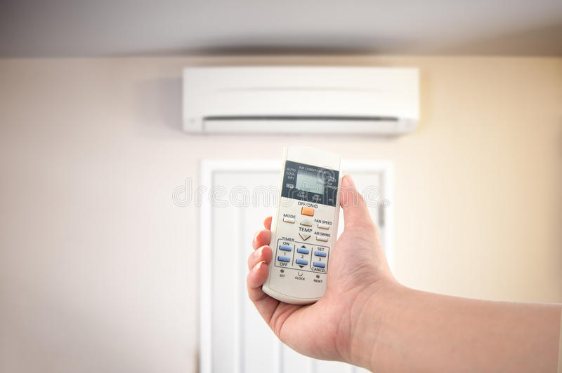 Closeup view about using some appliance such as air condition stock image