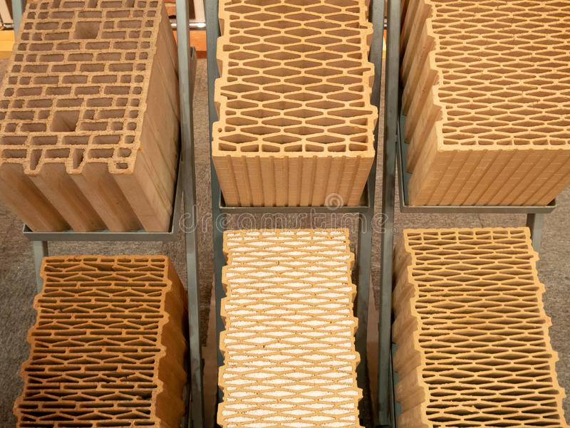 Closeup view on various types of building hollow red bricks with different patterns inside. samples for sale at diy store.  stock images