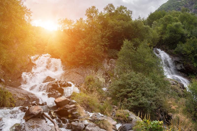 Closeup view waterfall scenes in mountains, national park Caucasus, Russia. Closeup view waterfall scenes in mountains, national park Dombai, Caucasus, Russia royalty free stock image