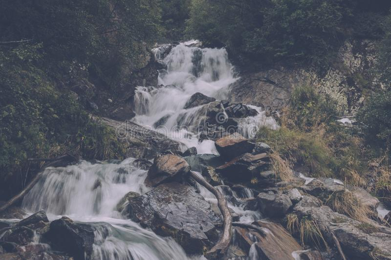 Closeup view waterfall scenes in mountains, national park Caucasus, Russia. Closeup view waterfall scenes in mountains, national park Dombai, Caucasus, Russia royalty free stock photo