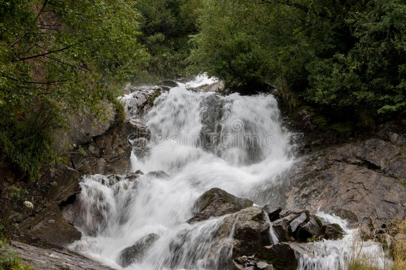 Closeup view waterfall scenes in mountains, national park Caucasus, Russia. Closeup view waterfall scenes in mountains, national park Dombai, Caucasus, Russia stock photography