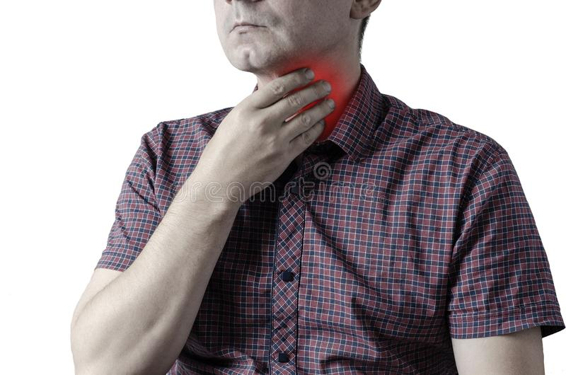 Closeup view of a young male with a sore throat or pain on the neck or thyroid. The concept of body problems of people.  stock image
