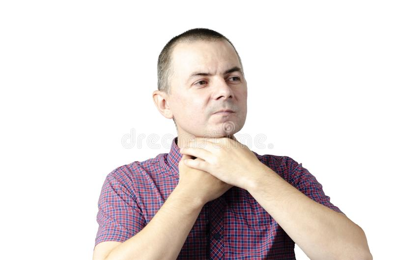 Closeup view of a young male with a sore throat or pain on the neck or thyroid. The concept of body problems of people.  stock photos