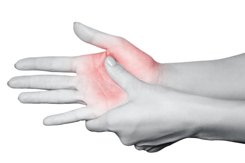 Closeup view of a young woman with pain on hand. stock images