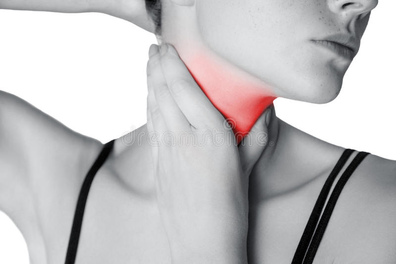 Closeup view of a young woman with pain on neck or thyroid gland. Isolated on white background. Black and white photo with red dot royalty free stock images