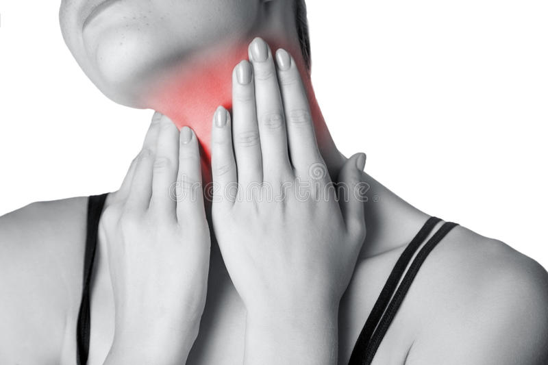 Closeup view of a young woman with pain on neck or thyroid gland. Isolated on white background. Black and white photo with red dot royalty free stock photo