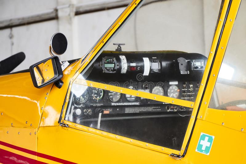 Closeup view of Zlin Z-37 Cmelak agricultural airplane cockpit from outside made in Czechoslovakia. stock images