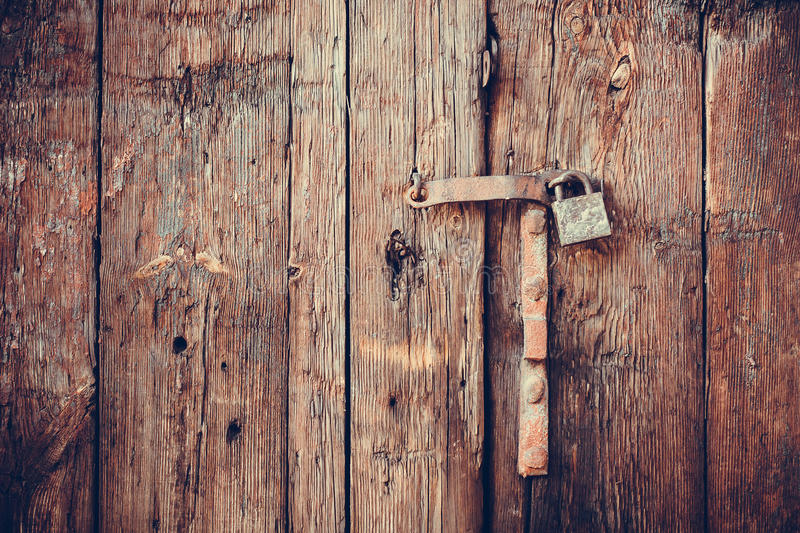 Closeup vintage old wooden door. In grungy style royalty free stock image