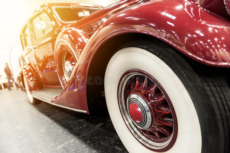 Closeup of a vintage red car. In the sunlight stock image