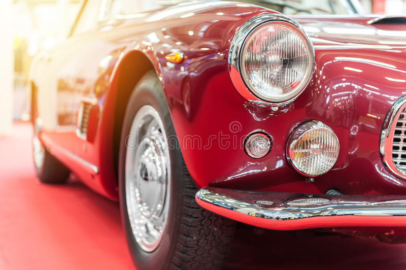 Closeup of a vintage red car. In the sunlight royalty free stock images