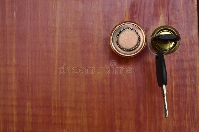 Closeup, vintage red wooden cabinet background with key royalty free stock photos