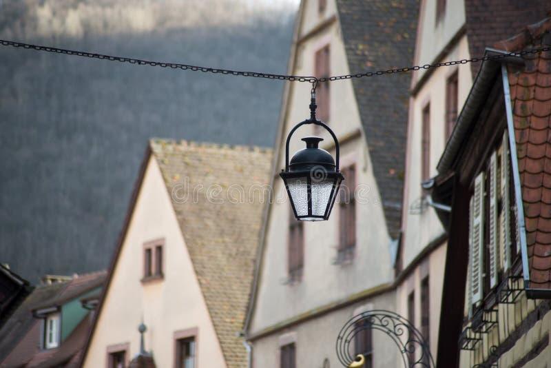 Vintage street lamp on medieval architecture background. Closeup of vintage street lamp on medieval architecture background stock photo