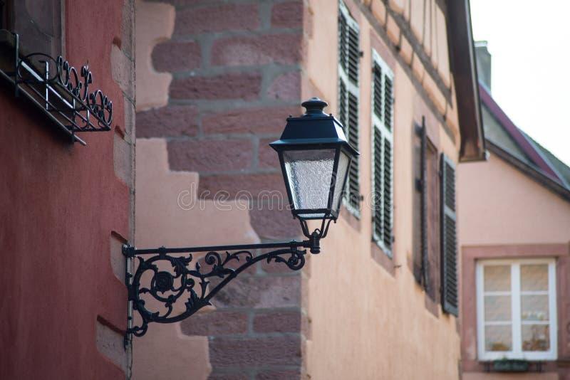 Vintage street lamp on medieval architecture background. Closeup of vintage street lamp on medieval architecture background royalty free stock photography