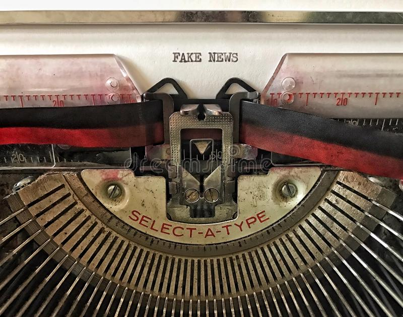 Closeup of vintage typewriter with the words Fake News royalty free stock photo