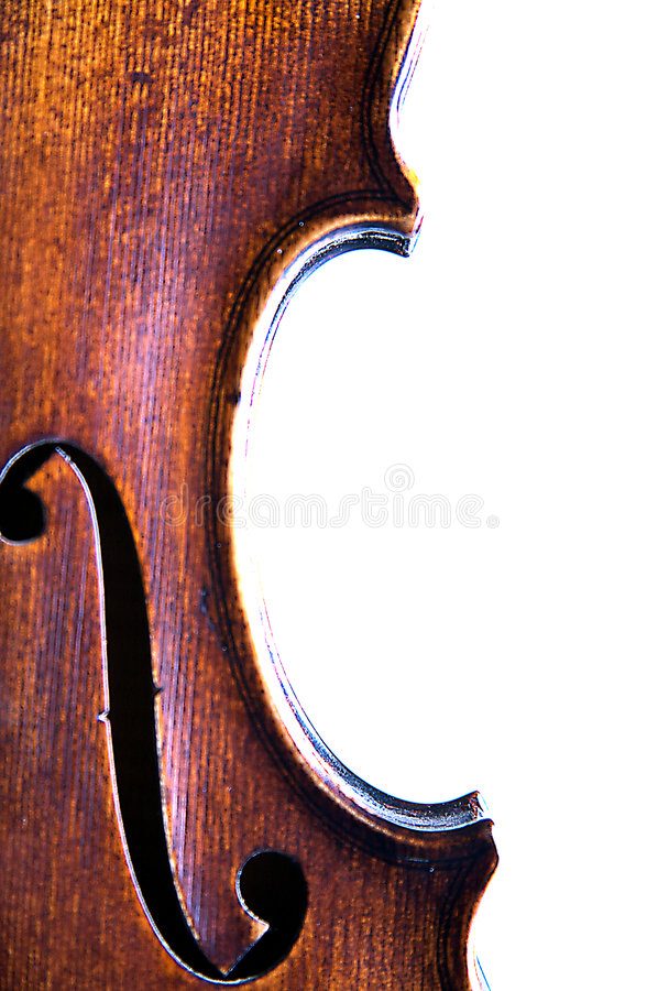 Closeup Violin F Hole. A closeup of a violin F hole isolasted against a high key white background with copy room in the vertical or portrait view stock images