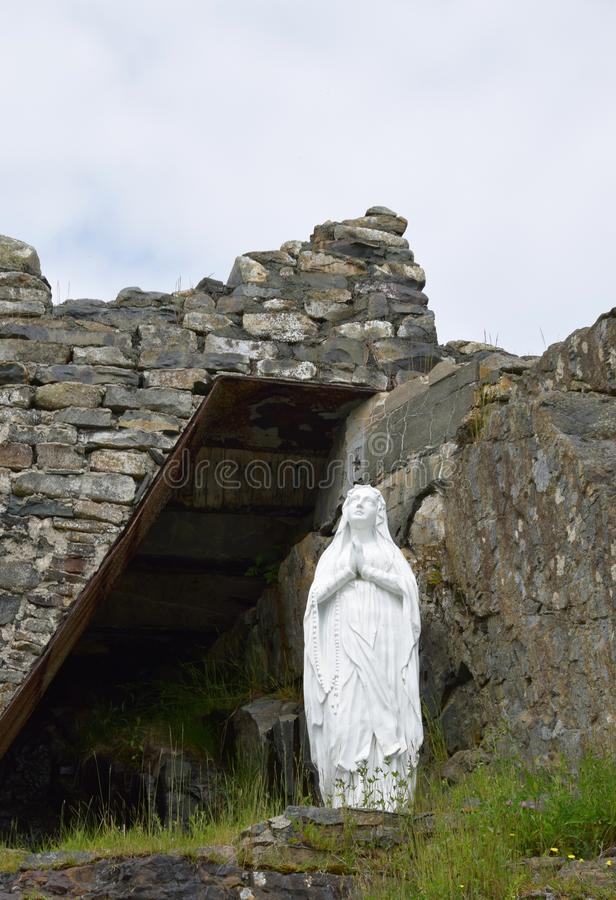 Our Lady of Lourdes Grotto, Flatrock, NL. Closeup of the virgin Maria praying near a man made Grotto royalty free stock images