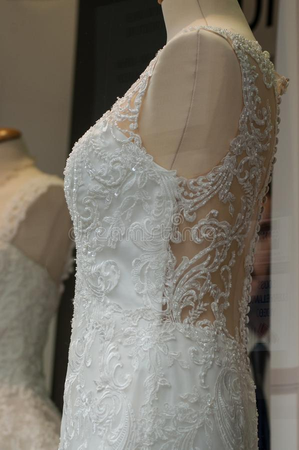 Wedding dress on mannequin in fashion store for women. Closeup of wedding dress on mannequin in fashion store for women royalty free stock images