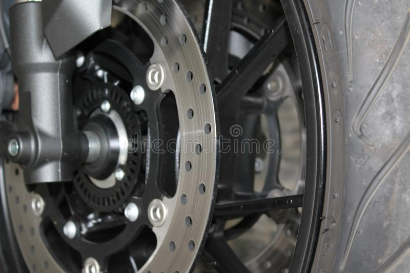 Wheel motor with disk brakes. Closeup of wheel motor with disk brakes with large inflated tires royalty free stock image