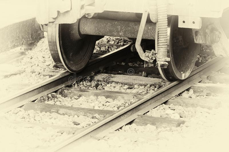Closeup wheel of a train on the railroad at the station. with image vintage tone stock image