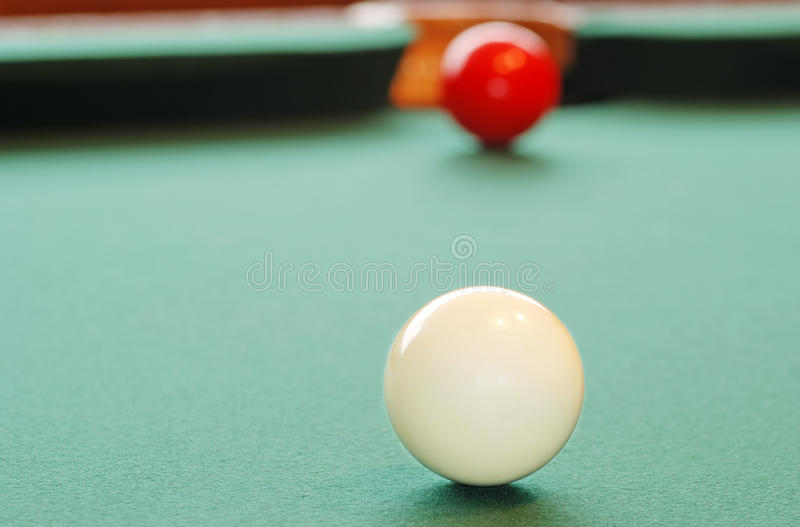 Closeup White Billiard Ball. With red one near corner pocket stock image
