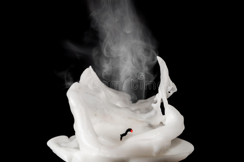 Closeup of white blown out and smoking candle royalty free stock photo