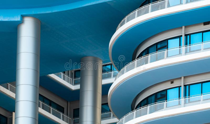 Closeup white and blue building with glass window. Modern architecture. Exterior building. Architectural details of modern royalty free stock images