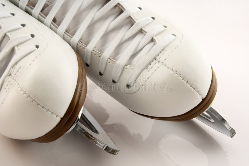 Closeup of white figure skates. Closeup of elegant white figure skates stock images