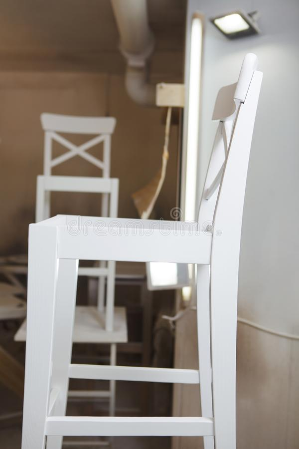 Closeup of white just painted chair in workshop. royalty free stock photo