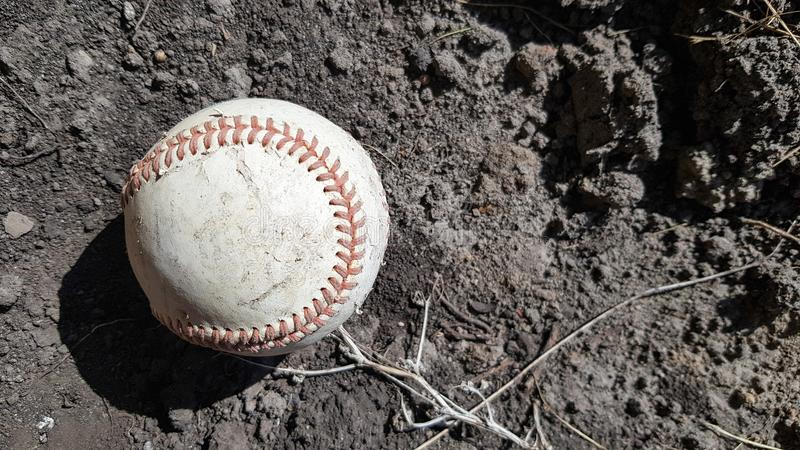 Closeup White leather textured baseball ball with red seams. Ball Outside Stadium Home Run Concept royalty free stock photography