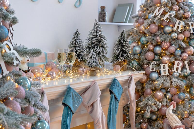 Closeup of white living room with big windows and Christmas New year decor,light garland and champagne glass stock photography