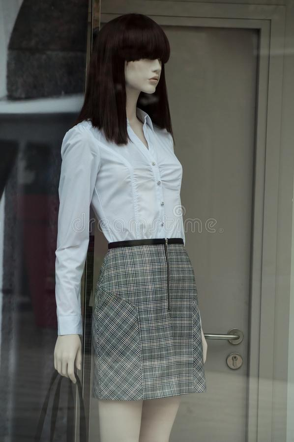 white shirt and grey skirt on annequin in fashion sto stock photography