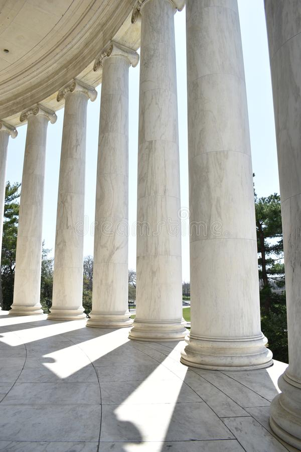 Closeup of white stone pillars at the Jefferson Monument on Lake Tidal Basin in Washington D.C in the USA. Closeup of big white stone pillars at the Jefferson royalty free stock photography