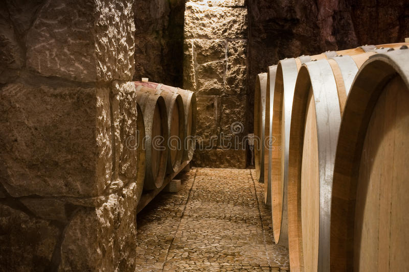 Closeup of Wine Barrels in a Wine Cellar stock image