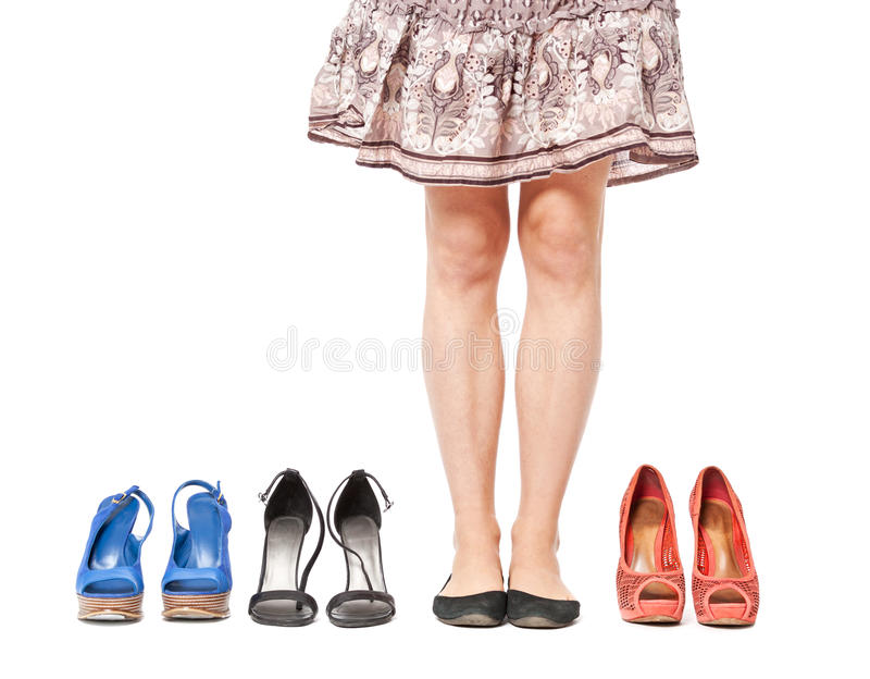 Closeup of woman choosing a pair of shoes - isolated on white. royalty free stock photos