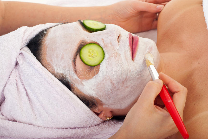 Closeup of woman with facial mask royalty free stock image