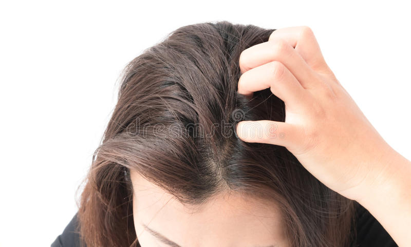 Closeup woman hand itchy scalp, Hair care concept.  royalty free stock images