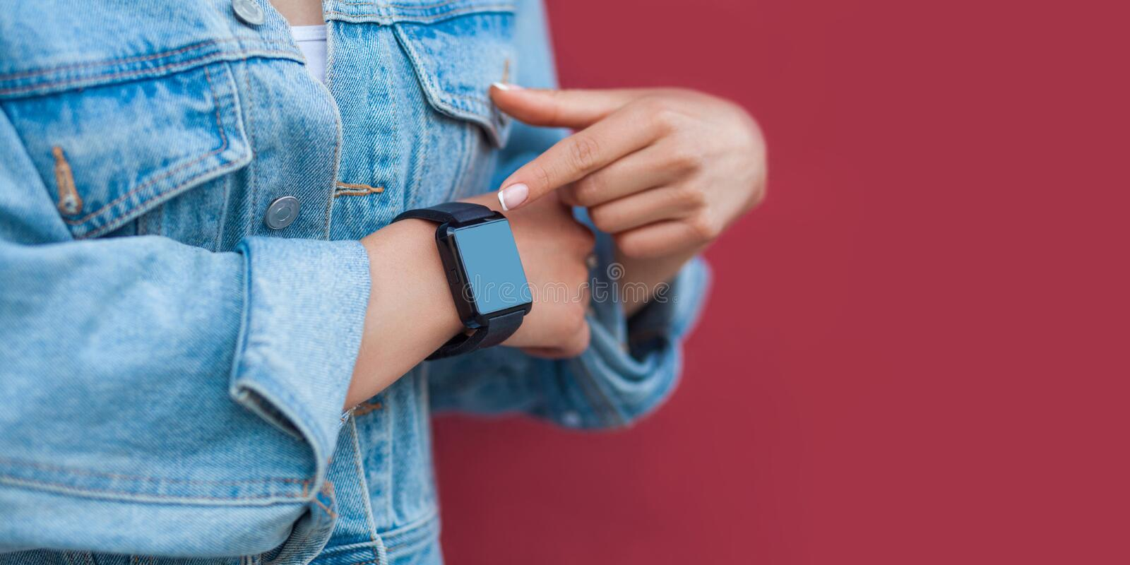 Closeup of woman hands in casual style with black smart watch pointing or touching and screen copyspace stock photos