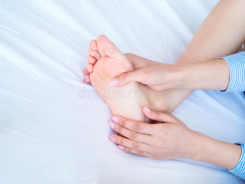 Closeup woman hands doing foot massage royalty free stock images