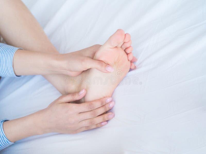 Closeup woman hands doing foot massage stock photography