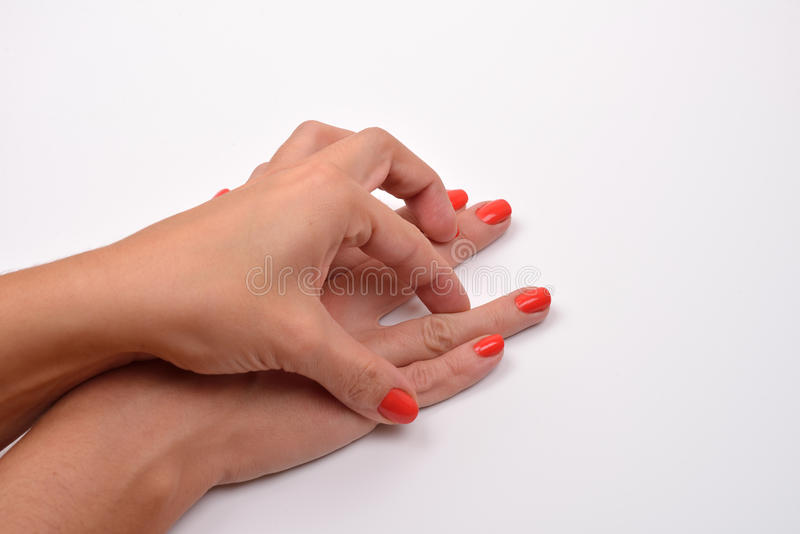 Closeup of woman hands making sign, playing together on white stock photography