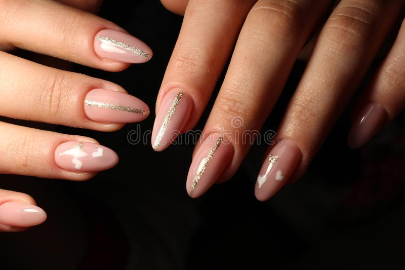 Closeup of woman hands with nail design. stock photo