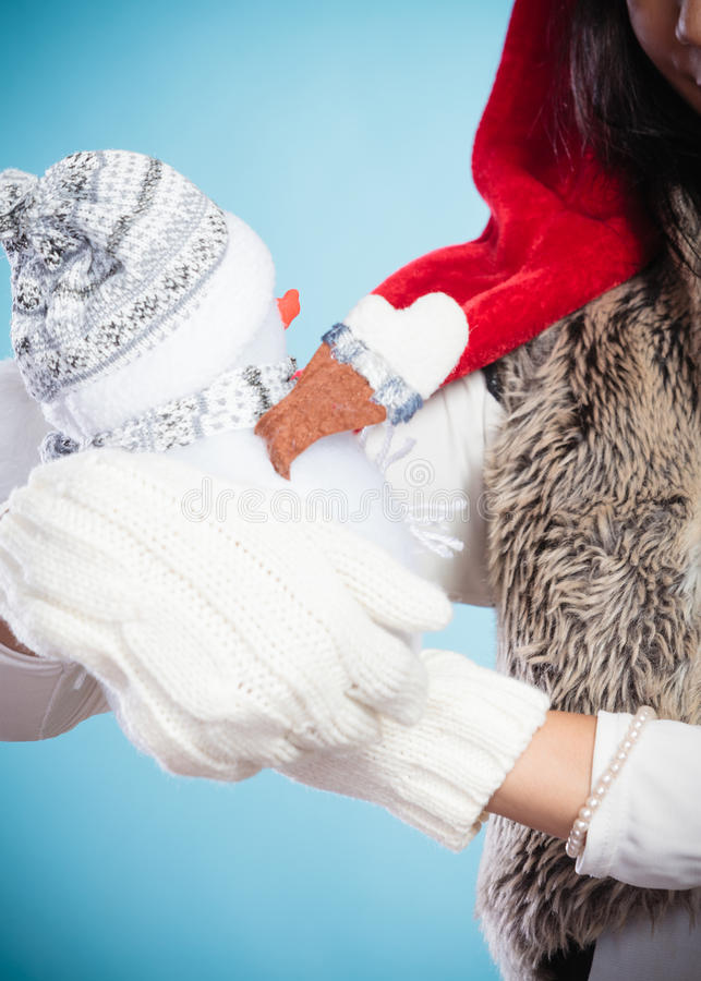 Closeup of woman with little snowman. Christmas. royalty free stock image