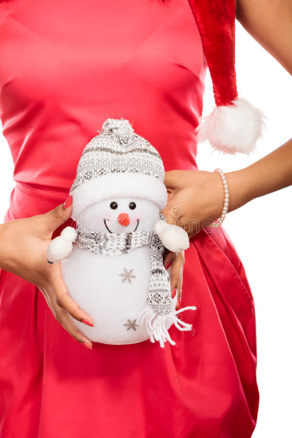 Closeup of woman with little snowman. Christmas. stock photo