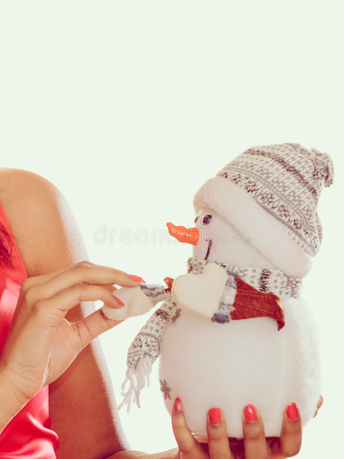 Closeup of woman with little snowman. Christmas. royalty free stock photo