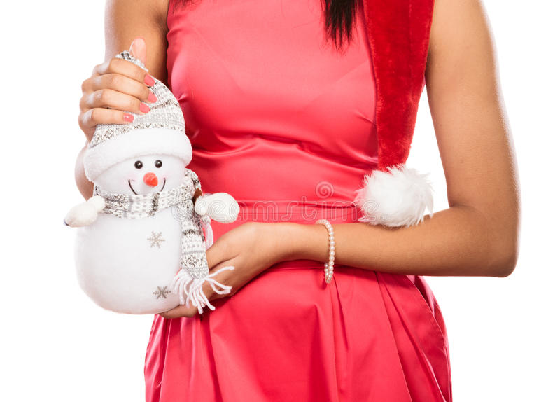 Closeup of woman with little snowman. Christmas. stock images