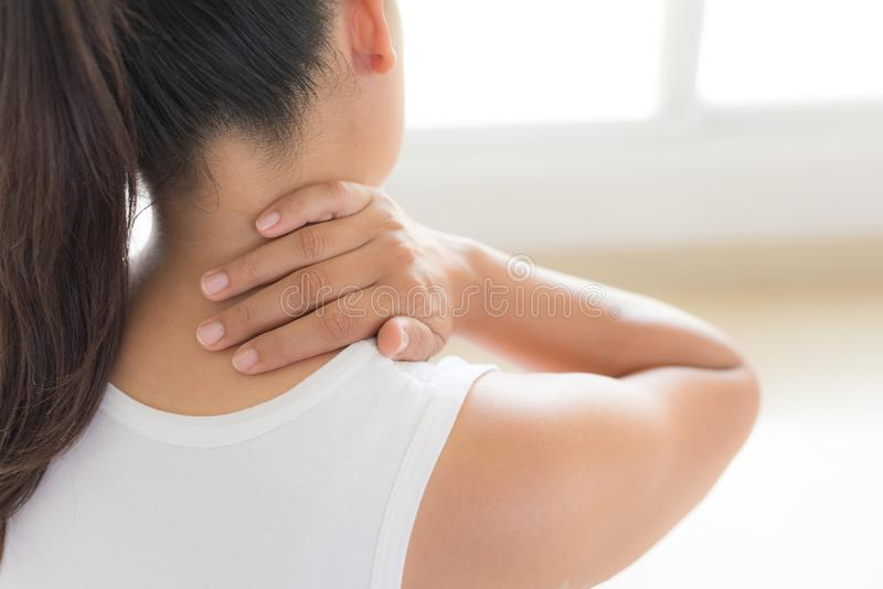 Closeup woman neck and shoulder pain and injury. royalty free stock images