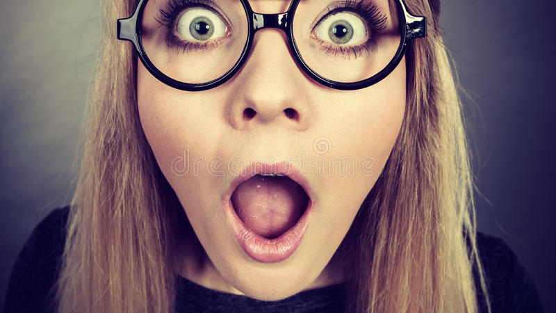 Closeup woman shocked face with eyeglasses royalty free stock photos