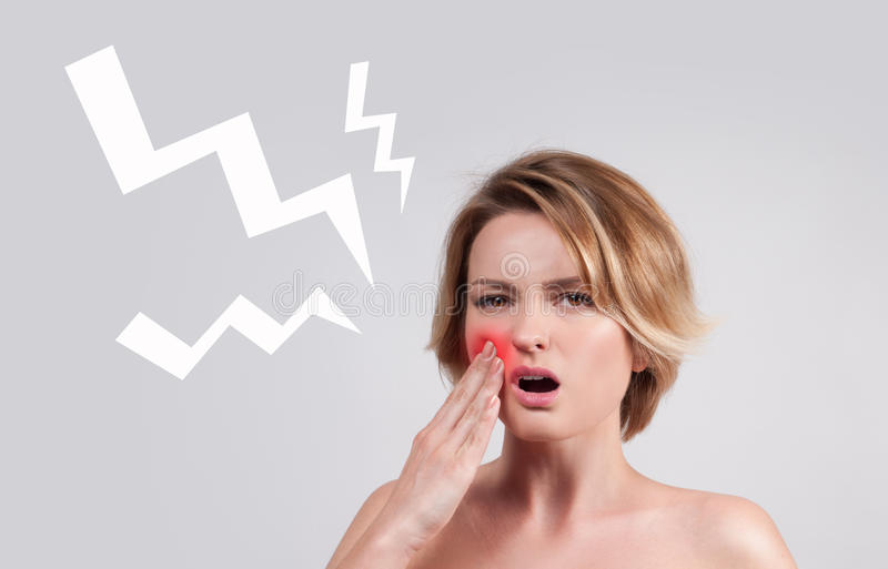 Closeup of woman suffering from toothache royalty free stock image