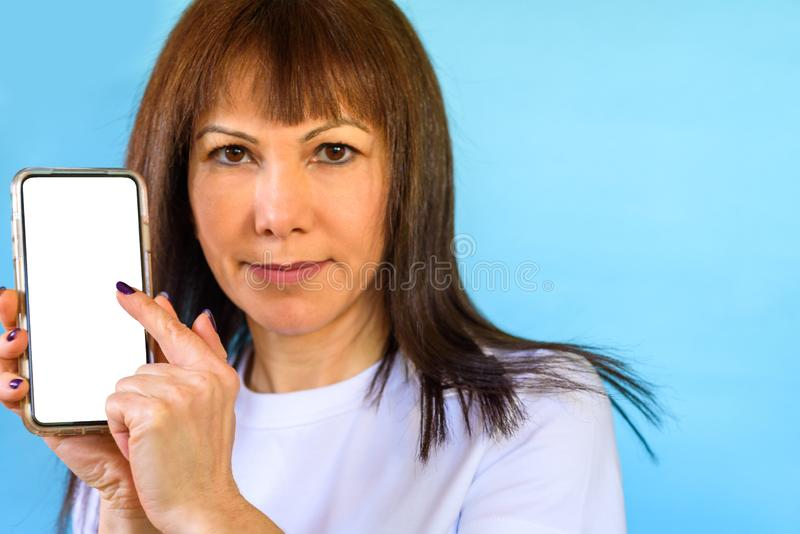 Closeup of woman using smartphone. Mock up mobile phone white color blank screen. royalty free stock images